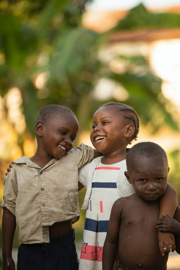 happy african children embracing on street