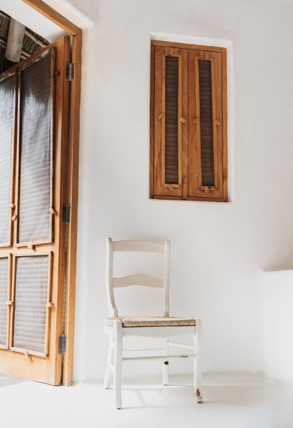 photo of chair near wooden door