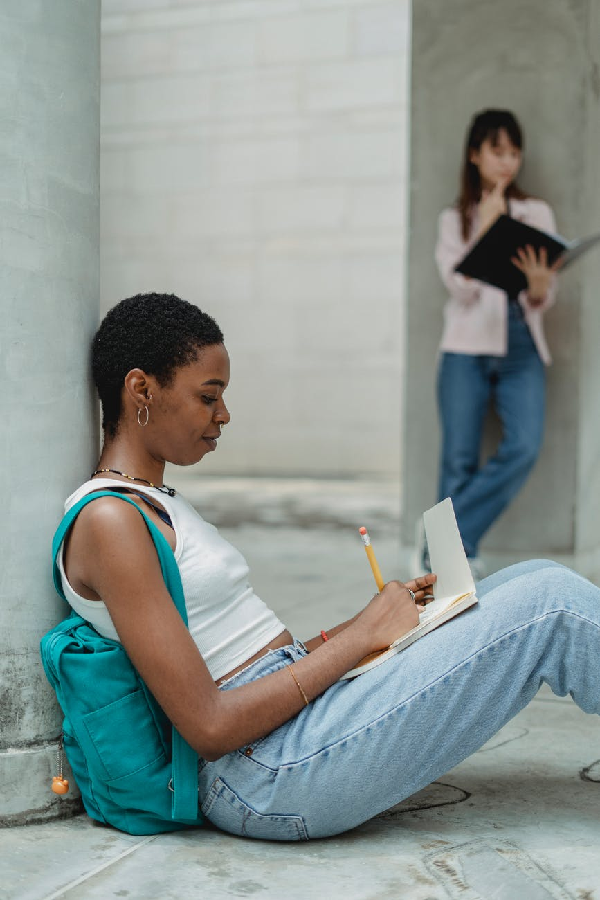 diverse students doing homework together